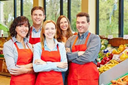 29682805 happy staff team with men and women in a supermarket